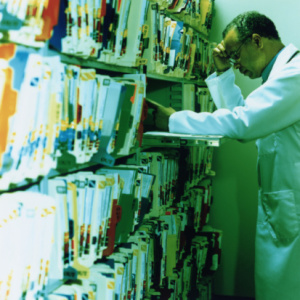 Doctor Searching Files for EMR